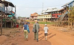 Cambodia_123112_Melissa_Oliver_volunteers_walking_down_a_dirt_road_good_photo